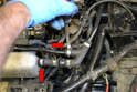 Next remove the vacuum lines from the top of the intake manifold (red arrows).