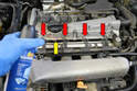 You are going to be opening holes that go into the engine so before you begin get a can of compressed air (yellow arrow) and blow all the dust and debris away from the injector ports (red arrows).