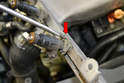 The injectors are held on by metal clips; they can be pried or pulled off the rail (red arrow).