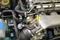 Begin by locating the intake air temperature sensor (yellow arrow) just behind the throttle body.