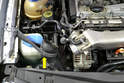 With the clamp off wiggle the hose off the throttle body and tie it aside out of the way (yellow arrow).