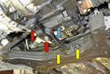 With the car safely lifted locate the bog bone mount (blue arrow).