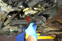Pull the complete mount (red arrow) from the car.
