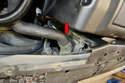 Remove the radiator hose clamp and hose (red arrow).