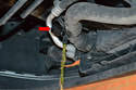 With the tray removed you will see radiator drain plug on the lower left front of the car.