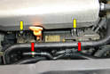 At the front of the engine remove the two 10mm nuts (red arrow) and the two 5mm Allen bolts (yellow arrows).