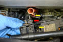 With the bolts removed lift the shelf up and off the dip stick tube (yellow arrows) and remove the electrical connection (red arrow).