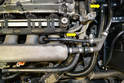 Disconnect the two vacuum lines (yellow arrows) that run across the front of the engine and tie them out of the way.