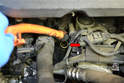 Remove the dipstick tube by pulling it straight up (red arrow).