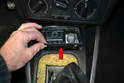 Slide the ash tray unit forward then up and out of the console (red arrow).