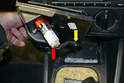 Flip the ash tray assembly over and unplug the cigarette lighter (red arrow) and detach where the wiring clips to the assembly (yellow arrow).