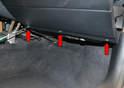 Remove the three lower T20 Torx screws (red arrows).