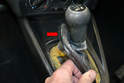 The front of the boot has a ridge in it that sits in the front of the shifter opening.