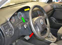 Using the steering column adjustment (red arrow) pull the steering wheel away from the dash (yellow arrow) and lower (green arrow) it as far is it will go.