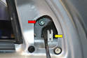 Use a T45 Torx and remove the bolt holding the housing to the door frame (red arrow).