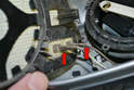 If you have a heated mirror carefully remove the two wires (red arrows) going to the heating element in the glass.