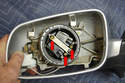 To replace the motor, remove the three Philips head screws (red arrows) holding the motor in place.