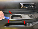 Use a trim removal tool and gently pry up the pull handle and switch housing (red arrows).
