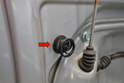 When you remove the panel from the door some of the plug clip combinations may stay in the door frame (red arrow), if this happens just use your trim removal tool and remove them from the door.