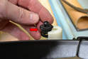 Reinsert the plug into the clip holder in the door panel (red arrow).