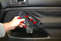 This photo illustrates the three clips that hold the handle face plate on (red arrows).