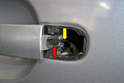 Inside the handle is a small rubber piece (red arrow) attached to a cable (yellow arrow) that goes to the door lock assembly.