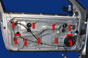 Remove the eleven 10mm bolts from the door panel (red arrows).