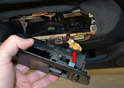 Turn switch housing over and remove the wiring connection (red arrow).