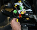 Make sure to disconnect the harness clip (yellow arrow) from the connector mount (red arrow) on the bottom of the seat.