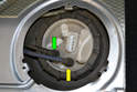 Remove the fuel supply line (green arrow) and the fuel return line (yellow arrow).