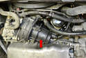 The air pump (red arrow) is located at the lower front right of the engine between the oil filter and power steering pump.