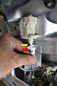 Separate the arm connecting the lock to the actuator by slipping the lock arm (red arrow) out from the actuator base (yellow arrow).
