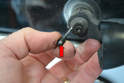 To replace the washer nozzle (red arrow) simply pull it straight back and out from the mounting post.