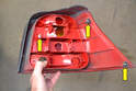 This photo illustrates the taillight housing removed from the car.