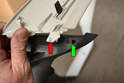 The lower section is attached to the upper section by a clip (red arrow) that sits inside the lower section (green arrow).