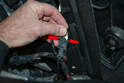 With the taillights removed, disconnect the electrical harness for the license plate lights.