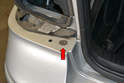 Remove the two T30 Torx screws from the top of the bumper cover on each side of the trunk opening (red arrow, one shown).