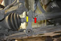 You will need two 16mm wrenches or sockets to remove the nut (red arrow) and bolt (yellow arrow) that holds the link to the sway bar.