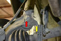 There is an 18mm nut (yellow arrow) and bolt (red arrow) that â€Ã...