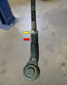 Use two 19mm wrenches or two large adjustable wrenches to unscrew the tie rod end (yellow and red arrows).