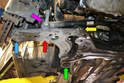 This photo illustrates the front control arm from under the car (red arrow).