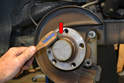Clean the mounting area of the flange with a wire brush (red arrow) to give you a good clean and flat mounting surface.
