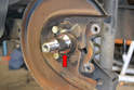 Clean the stub axle and check for any signs of damage (red arrow).