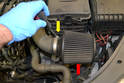 Install the air filter to the intake end of the pipe (red arrow) and tighten down the clamp (yellow arrow).