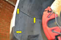 There are four T25 Torx screws holding the lower liner to the vehicle Three in the front of the wheel well (yellow arrows) and one on the lower front edge (not shown).