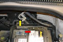 Front Seats - Disconnect the ground strap (yellow arrow) from the negative terminal on the battery (red arrow).