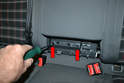 Rear Arm Rest: Use a T30 Torx and remove the two Torx screws (red arrows).