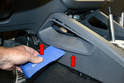 Use a trim removal tool and gently pry out the insert pieces on the grab rail in the center console (red arrows, both sides).