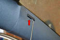 A Pillar Upper: Use a pick or very small screwdriver and very carefully remove the airbag badge (red arrow).