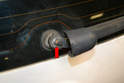3: To remove the wiper arm use a 13mm wrench and remove the nut (red arrow).